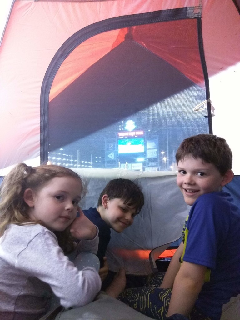 Cameron, Trevor and Allison getting ready for bed at the Mud hens game.